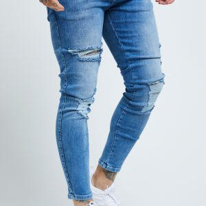 Skinny Distressed Jeans – Mid Wash